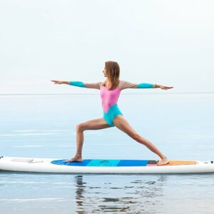 woman doing yoga on stand up paddle board
